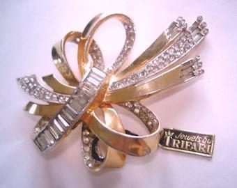Crown Trifari Clear Rhinestone Bow Brooch Gold Tone.