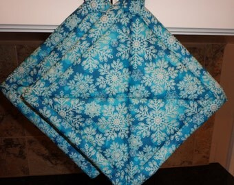 Christmas Snowflakes on Bluish Teal Quilted Potholders or Hotpads Set