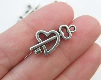 BULK 30 Heart and key charms ( double sided ) 23 x 12mm antique silver tone H24