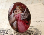 """Handmade """"In the Arms of an Angel"""" 40x30 mm glass oval cabochon, 40x30mm 30x40mm, rose pink, protection, Christmas, religious icon, child"""