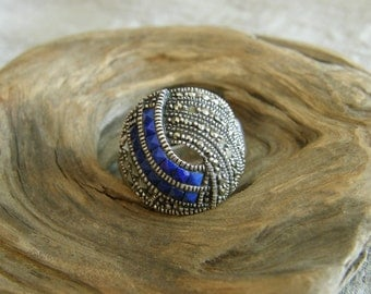 Vintage Art Deco sterling and marcasite ring with blue glass stones  circa the 1920's