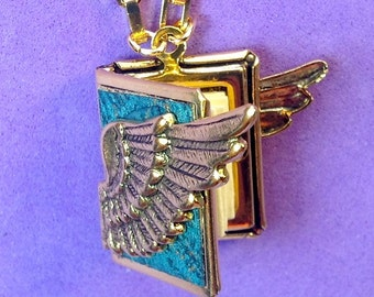 Winged Peace Locket - aquamarine and gold, holding 14 words for 'peace' from around the globe.
