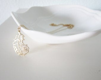 Tiny feather necklace on gold filled chain, dainty pretty jewelry SALE