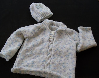 Hand knit baby girl's pullover sweater and hat