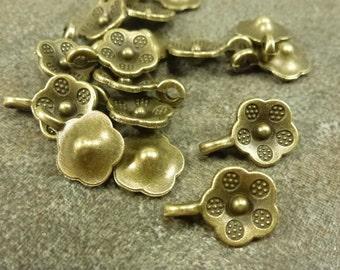 25pc. Sculpted Flower Drop Bronze 13x9mm Antiqued Charm Pendant