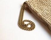 Beige and golden rectangular crochet clutch, with golden chain handle