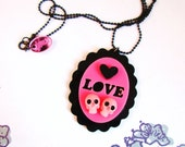 BLUSHING LOVERS CAMEO- Laser Cut Acrylic Bubblegum Pink Double Skull Pendant Necklace