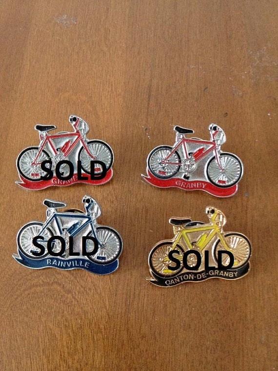 vintage red, blue and yellow bicycle pins