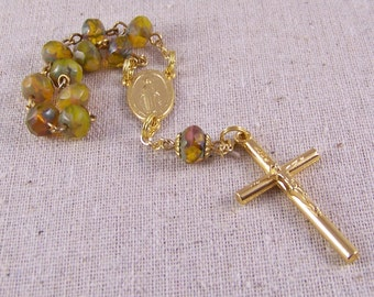 Handmade Catholic pocket rosary or tenner in gold with green and amber fancy Czech rondelles