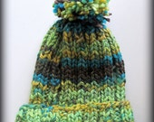 Green turquoise brown and gold hand knit pom pom hat