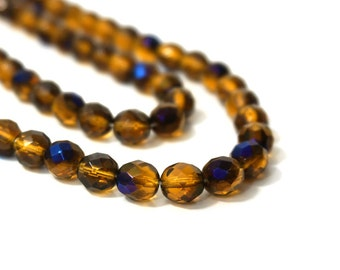 8mm faceted glass beads, honey yellow with blue iris finish, full & half strands available  (853F)
