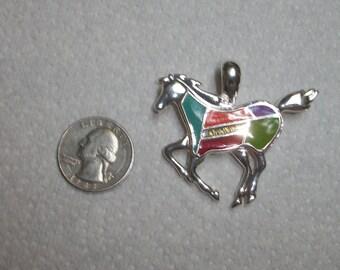 artsy silver horse pendant