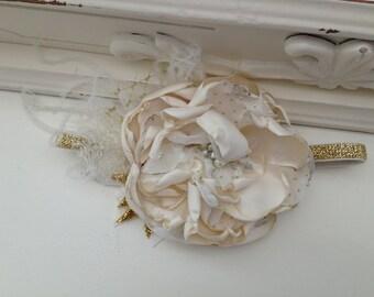 Ivory flower glitter gold band.