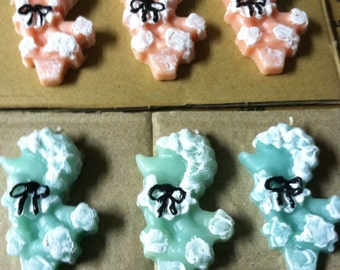 Pink and blue poodle candles