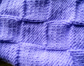 Hand knitted baby blanket, in a variety of colors.