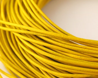 LRD0110022) 1.0mm Yellow Genuine Round Leather Cord.  1 meter, 3 meters, 7.3 meters, 12.3 meters.  Length Available.