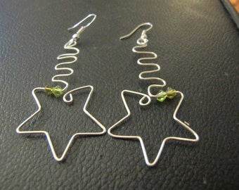 Silver wire wrapped star earrings with green and yellow Swarovski crystals