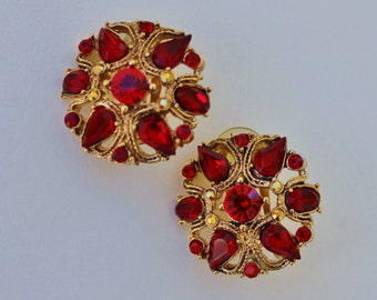 Vintage Signed St John Gold Tone Ruby Garnet Red Glass Rhinestone Cluster Teardrop Open Work Crest Clip On Earrings