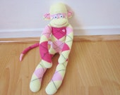 Strawberries and cream argyle sock monkey doll - light pink, pale yellow, and magenta sock monkey toy