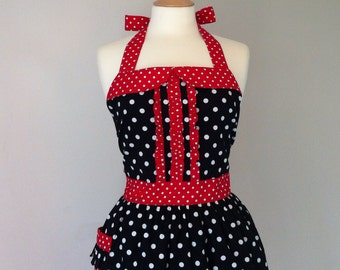 Retro apron with ruffles, white polka dots on black fabric, fully lined.