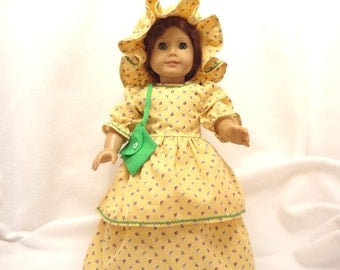 Yellow floral print, long dress for 18 inch dolls, with bright green baby rick-rack trim.