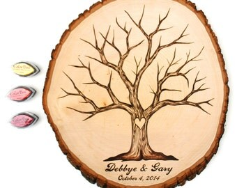 Fingerprint Tree Design: Wood slice rustic theme wedding guest books. Personalized