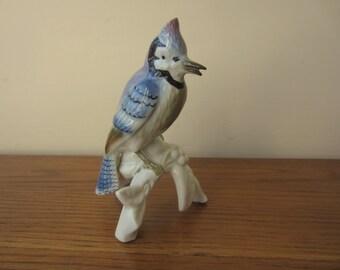 Bird statue by Gerold Porzellan perched porcelain blue bird.