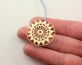 MANDALA brass handsawed pendant with baby blue nylon cord