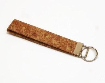 key fob key chain lanyard wristlet brown metallic