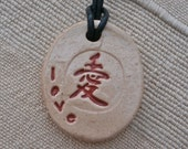 ceramic love pendant, pendant with Chinese love symbol on leather cord