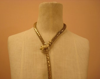 Gold serpent collar by Whiting and Davis
