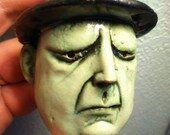 Miniature Mask of Man in green with hat