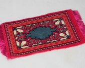 Lot of vintage dollhouse rugs and textiles - pink tobacco felt rug, velveteen runners and more