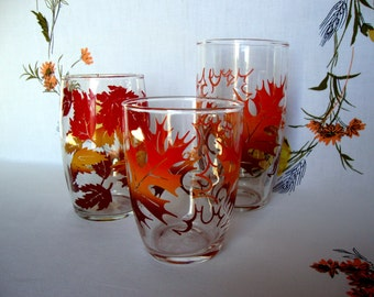 Trio of autumn leaf leaves glasses orange brown and yellows