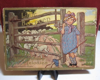 1914 antique COLGATE children's advertising booklet Little Bo-peep and other mother goose melodies with ads for cashmere talcum
