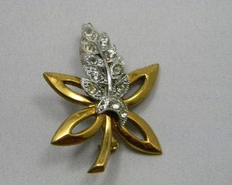 Vintage rhinestone gold and silver tone leaf motif brooch