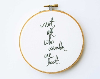 Gray embroidery hoop art / not all who wander are lost / white fabric background / fresh home decor