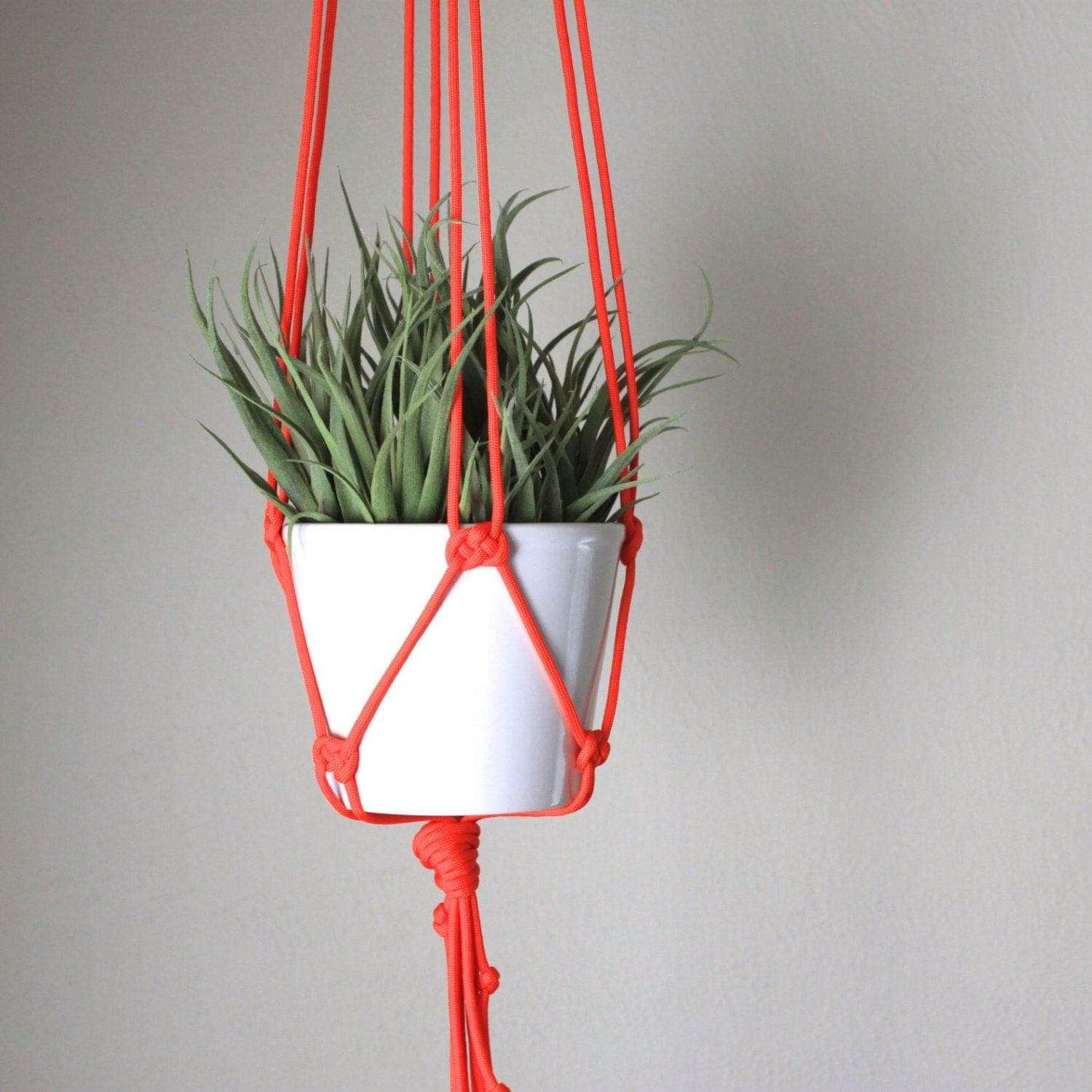 Modern Bright Orange Macrame Plant Hanger With White Planter