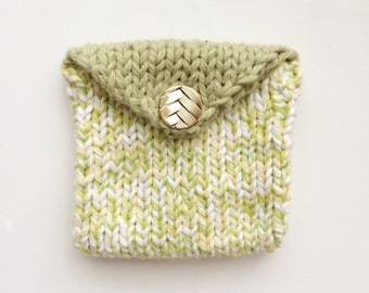Light green knit coin purse with button closure