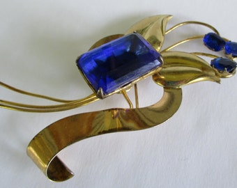 Vintage Harry Iskin gold tone brooch with blue rhinestone and glass settings art deco design