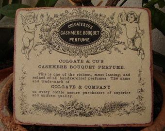 Colgate Cashmere perfume, Victorian style label, cherubs on wood. shabby chic small sign