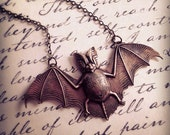 Brass Bat Necklace. Long Brass Chain. Mid Flight. Flying Bat. Spooky. Halloween. Unique Oddities. Unisex Gifts. Under 25. Vampire. Goth.