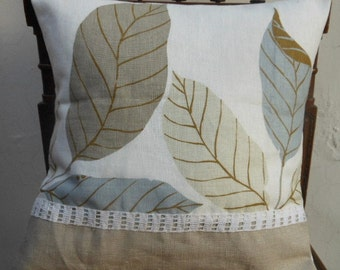 Patchwork linen cushion cover with a leaves pattern