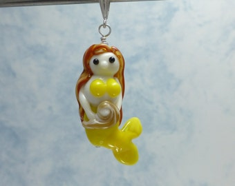 Glass Mermaid pendant in yellow holding seashell