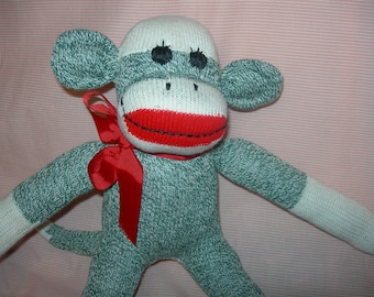 Traditional Classic Red Heel  Sock Monkey Doll In Green