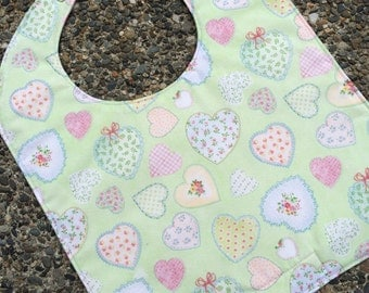 NEWBORN Bib: Hearts Tossed on Green with Block Hearts on Back, Personalization Available