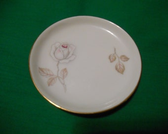 "One (1), 3 3/4"" Porcelain Coaster, from Johann Haviland, in the Dawn Rose Pattern."