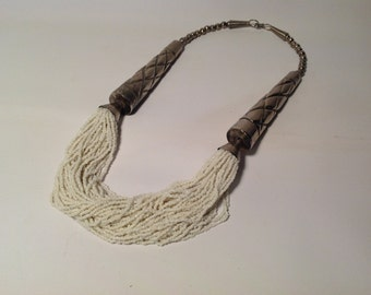 Vintage necklace with silver horns and white drapping beading