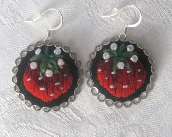 Hand embroidered earrings with red delicious strawberries.