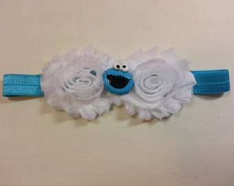 White Shabby Chic Flowers on a Blue Headband with Cookie Monster Embellishment